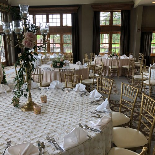 elegant wedding with gold chiavari chairs and round tables in michigan