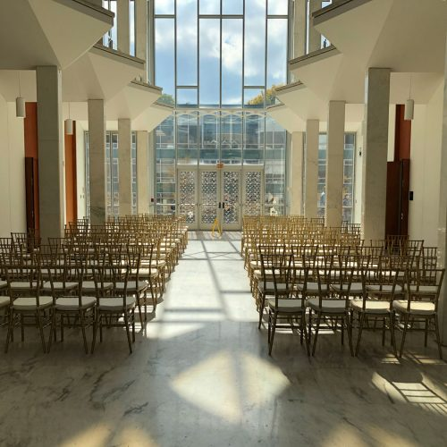 indoor wedding ceremony with chiavari chairs in detroit michigan